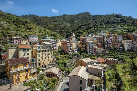 View at high land part of Manarola village with the ball tower in the center. Cinque Terre National parc in the Northwest of Italy.