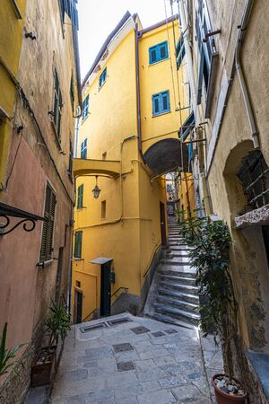 Arrow pass ways in old part of Vernazza village in Cinque Terre coastal area. Liguria, Italy.