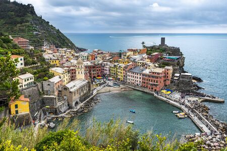 View at Vernazza village from the Monterosso Trail. The Marina port area is at foreground. Cinque Terre, Liguria, Italy. 写真素材