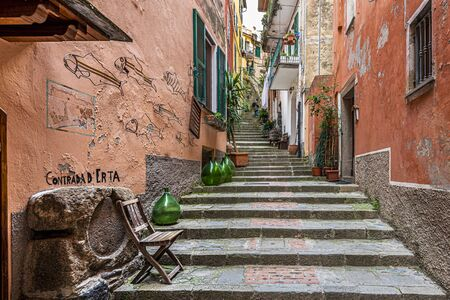 The arrow passage with steps in ancient village of Monterosso al Mare in Cinque Terre coastal area. Liguria region in Italy.