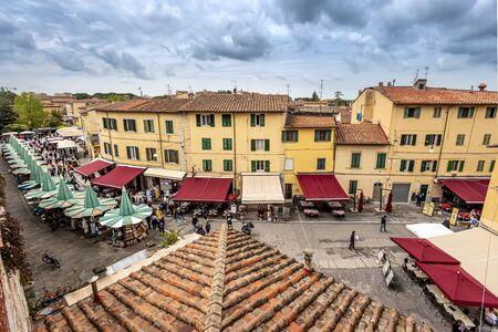 Pisa, Italy ? ?? May 3, 2019 View at the market area in historical Pisa town from the city wall.
