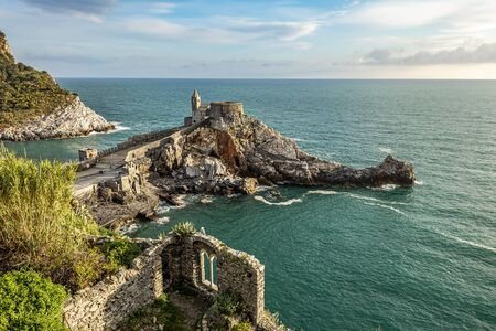Rocks with San Pietro Church in Porto Venere town as seen from Doria castle. Ligurian coast of Italy. 写真素材