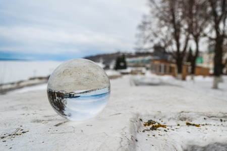 glass sphere: Crystal ball on the railing of the embankment of the Volga River in the city of Cheboksary.