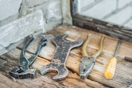 old tools: Old tools lie on the boards on the balcony Stock Photo