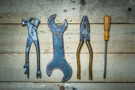 old tools: Old tools lie on the boards. Top view of a wrench, vernier calipers, pincers.