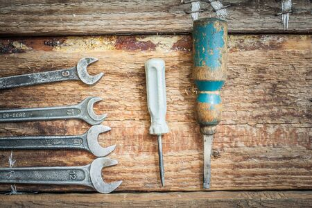 old tools: Old tools lie on the boards. Little old wrenches and screwdrivers.
