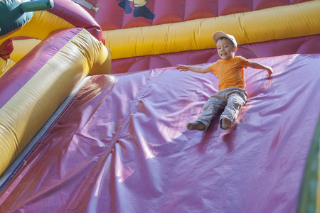 Children play and ride trampolines which are inflated with air. City Cheboksary, Chuvash Republic, Russia. 03/18/2016