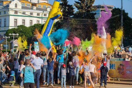threw: Participants of the festival of colors Holi together threw paint, Cheboksary, Chuvash Republic, Russia. The joy and emotions of people. 06012016 Editorial