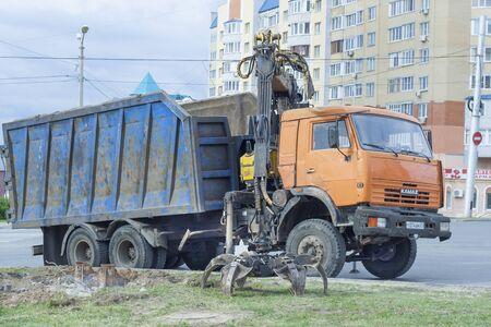 manipulator: KAMAZ trucks with manipulator (loader) in the city of Cheboksary, Chuvash Republic, Russia. Work on a city street. 07052016 Editorial