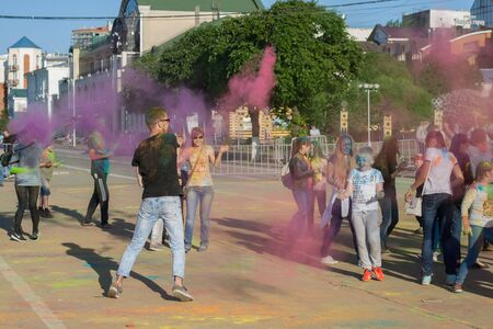 threw: The guy threw paint into a crowd of holy in Cheboksary, Chuvash Republic, Russia at the festival of colors. The joy and emotions of people. 06012016 Editorial