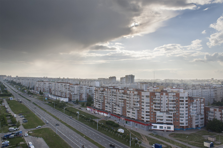 apartment tower old town: Urban landscape with a view of the avenue tratorostroiteley with the storm cloud before a strong thunderstorm. Horizontal frame. City Cheboksary, Chuvash Republic, Russia. Travel Russia. 05042016