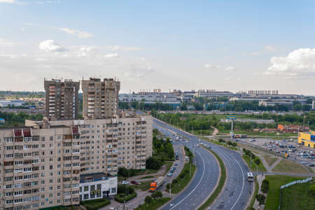 apartment tower old town: View to the street on Avenue tratorostroiteley and homes. City Cheboksary, Chuvash Republic, Russia. Travel Russia. 05042016