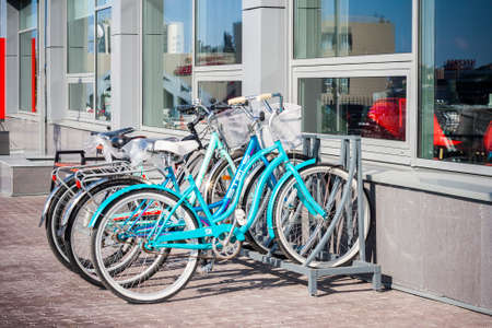 bike parking: Bike parking near modern building. A healthy lifestyle, a walk on the bike.