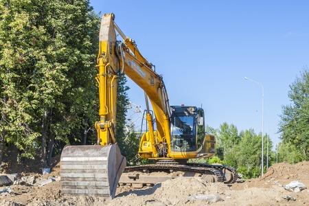 Excavator JCB on the heating main repair. City Cheboksary, Chuvash Republic, Russia. 08062016 Editorial