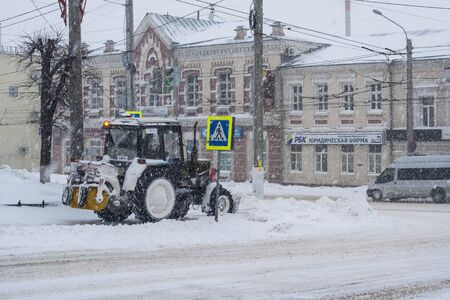 michigan snow: Special technique removes the snow from the street during a snow storm in poor visibility. Snow storm in the city of Cheboksary, Chuvash Republic, Russia. 01172016
