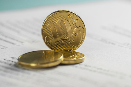 10 Russian rubles, coins lie on documents accounting. Documents for payment. Stock Photo