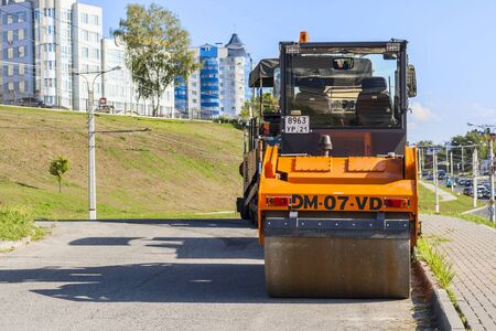 vibration machine: Roller for laying asphalt and other road equipment on the pavement on a clear day. City Cheboksary, Chuvash Republic, Russia. 08072016 Editorial