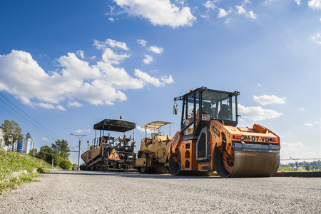 blacktop: Roller for laying asphalt and other road equipment on the pavement on a clear day. City Cheboksary, Chuvash Republic, Russia. 08072016 Editorial