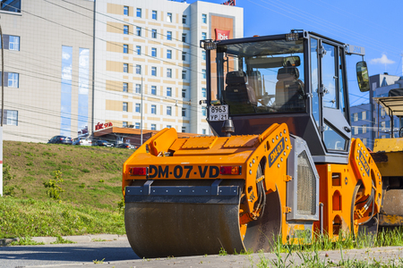roller compactor: Roller for laying asphalt and other road equipment on the pavement on a clear day. City Cheboksary, Chuvash Republic, Russia. 08072016 Editorial