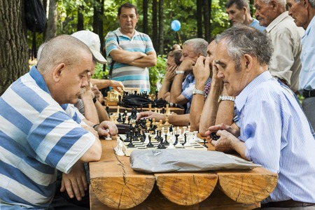 People in the city park play chess. City Cheboksary, Chuvash Republic, Russia. 08212016
