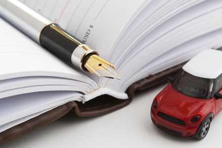 Pen business notebook. The handle is in a notebook. Registration of insurance on the car. on car expenses. The costs of the transport company.