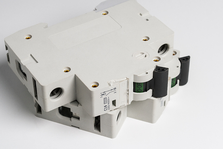 breakers: Circuit breakers on a white table. Stock Photo
