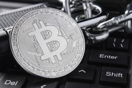 Silver bitcoin close-up. Electronic payments, blockchain technology. keyboard. stacking Фото со стока