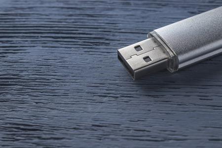 USB flash drive on a wooden background Standard-Bild