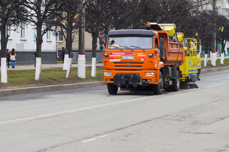 Street cleaning machine. Cleaning the spring street in a small town in Russia. City of Cheboksary, Chuvash Republic, Russia, 01052018