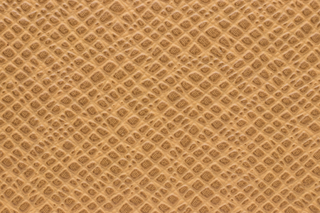 Synthetic brown leather for background Фото со стока