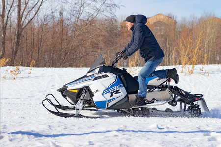 Snowmobile races in the snow. Concept winter sports, racers. City of Cheboksary, Russia, 03102019