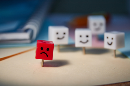 The concept of sadness, loneliness, disappointment. Shaped characters from office pins. Stock Photo