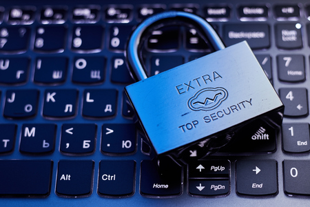 Selective focus on metal lock on keyboard password internet online data privacy information protection security concept in dark tone low key