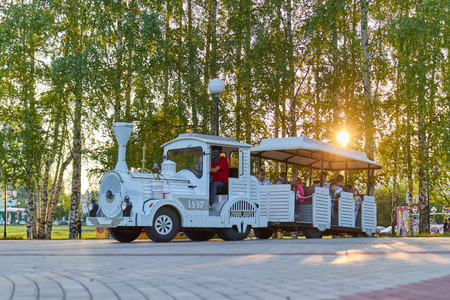 Children ride on the locomotive in the park. Cheboksary, Russia, 28.05.2019 Editorial