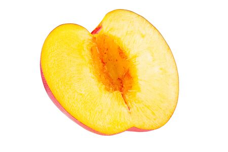 Nectarine fruit segment is isolated on a white background with the pen tool. The whole depth of field. 写真素材