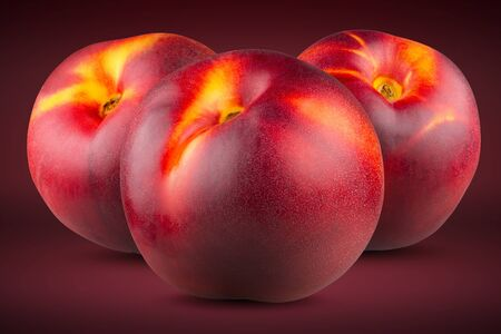 Three ripe peaches on a red(scarlet) background. Full depth of field. Stok Fotoğraf - 132064618
