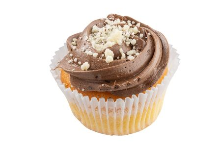 On a cupcake chocolate cream. All details in focus. Full depth of field. Stok Fotoğraf