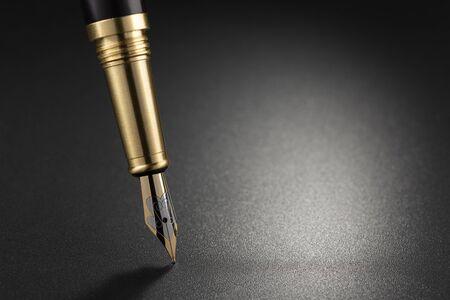 Fountain pen on top of a dark background Stok Fotoğraf