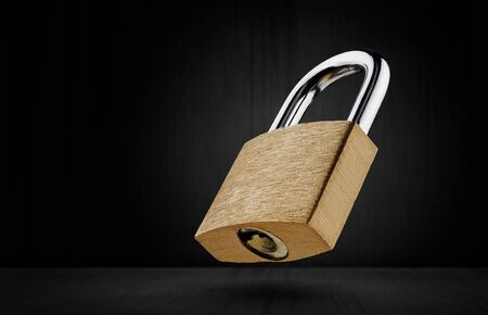Lock on a dark background. Safety concept. Free space for advertising.