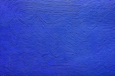 Abstract background of blue color from acrylic paints. Concrete background.