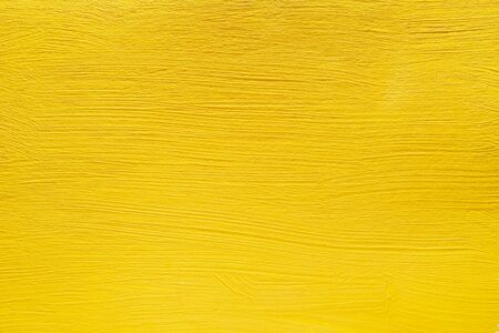 Abstract yellow background from acrylic paints. Concrete background.