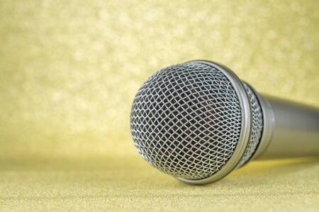 Microphone on a yellow background..