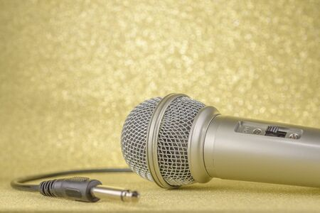 Microphone and plug on a yellow background.. 写真素材