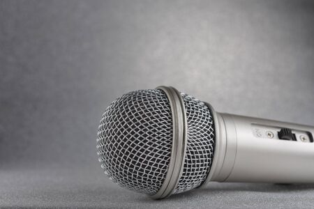 Microphone on a silver background..