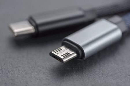 Micro USB cable with cable against a dark background..