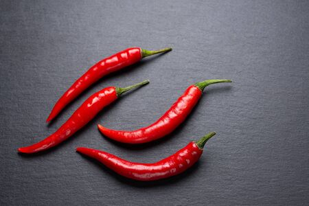 Red hot pepper on a dark background. Shale plate.. 写真素材