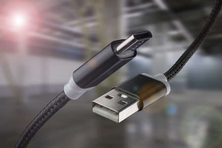 USB cable and USB type-C on an industrial background. Standard-Bild