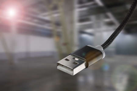 USB cable on an industrial background. Standard-Bild