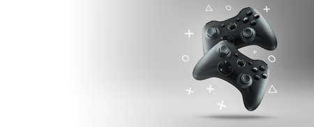 Two gamepads levitate on grey
