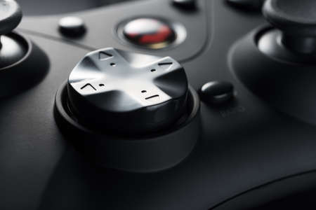 The arrow buttons of a black game controller. Game development. Retro video games. Game consoles.